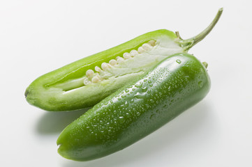 green chilli with drops of water, halved