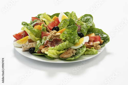 romaine lettuce with egg, olives, chicken and nuts