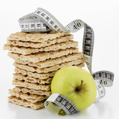 crispbread, in a pile, and apple with tape measure