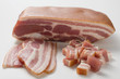 a piece of bacon, slices of bacon and diced bacon