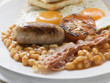 baked beans, sausage, bacon, tomato, fried eggs and toast