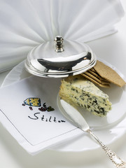 wedge of stilton with crackers and cheese knife