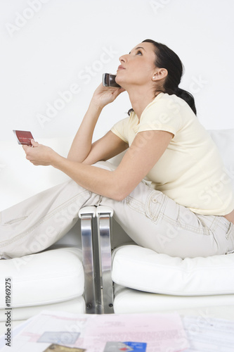 Woman Placing Order on Cell Phone