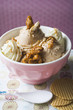 nut ice cream with caramelised nuts and cream
