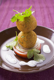 falafel (chick-pea balls) with tomato and yoghurt sauce