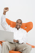 Man with Laptop Cheering