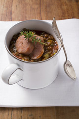 lentil stew with sausage and thyme in mug