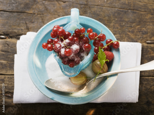 redcurrants in glass jug, sugar, gooseberries, raspberry