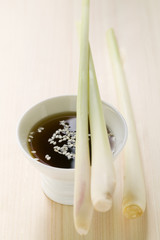 lemon grass on small bowl of soy sauce