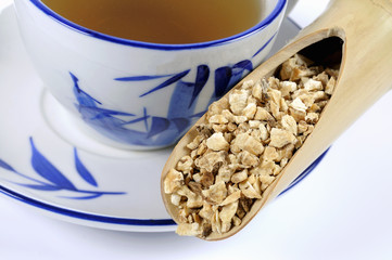 chinese angelica root with a cup of tea