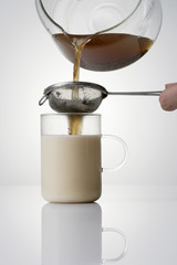 straining yogi tea into a tea glass