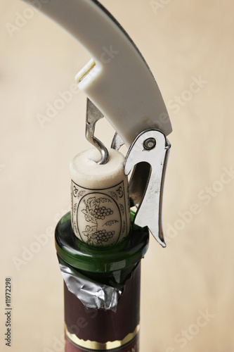 removing the cork from a wine bottle