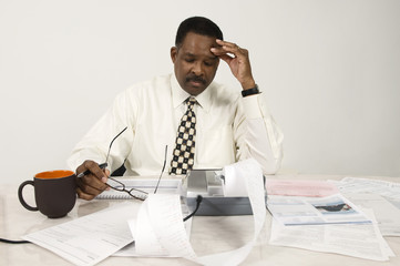 Businessman Using Adding Machine