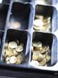 coins in an open till