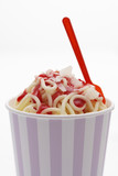 ice cream spaghetti with strawberry sauce in tub