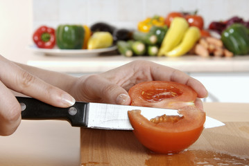 cutting up a tomato