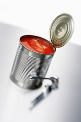 tomatoes in tin with tin opener