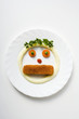 face formed from fish finger, mashed potato and vegetables