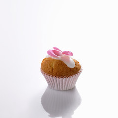 mini-muffin with icing and rose petal