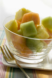 pineapple and melon fruit salad in a glass bowl