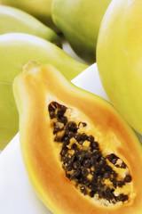 half a papaya beside whole papayas