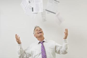 Man Throwing Bills in the Air