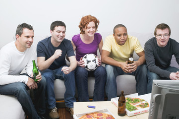 friends with football, beer & pizza sitting in front of tv