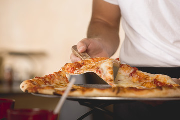 pizza margherita being served