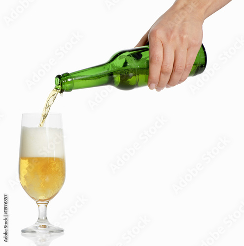 woman's hand pouring beer