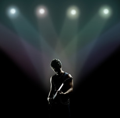 musician playing the guitar on the stage © ArtFamily