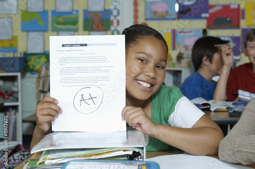 Girl presenting her test result