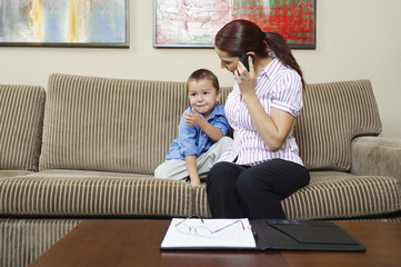 Businesswoman Working at Home with Son