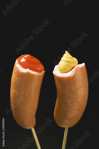 sausages with ketchup & mustard on wooden cocktail sticks