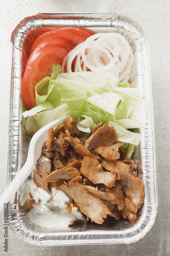 döner kebab with vegetables in aluminium dish
