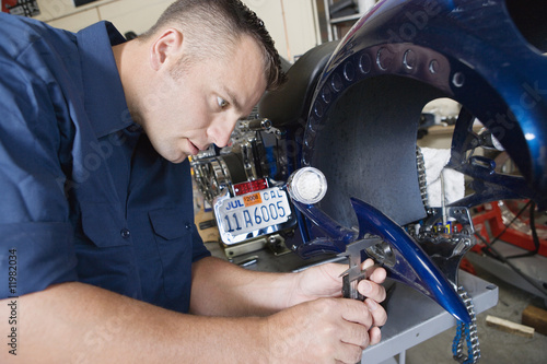 Mid-adult mechanic at work