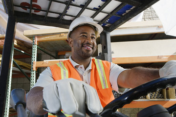 Worker Driving a Forklift
