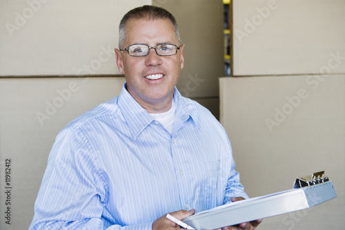 Man Holding Clipboard