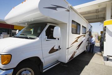 Man Refueling RV