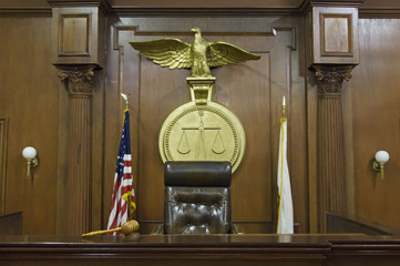 Legal scales behind judges chair in court