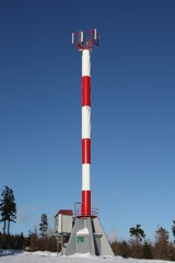 gsm antenna (telecomunications tower ) on blue sky