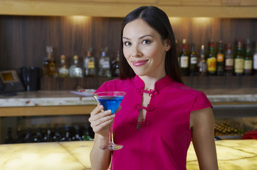 Woman Drinking a Blue Martini