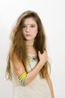 Long haired fashion girl showing bracelets