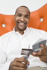 Man Cutting up Credit Cards