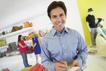 Man Signing a Receipt