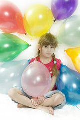 little happy giggle girl sitting with colour balloons. Girl cele