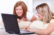 Cute girls sitting with laptop