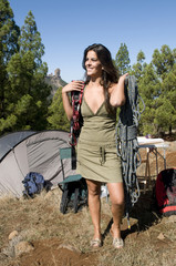 woman with camping material and equipment to climb