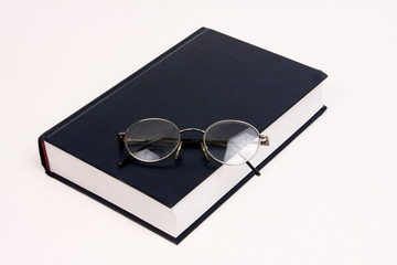Black book with reading glasses