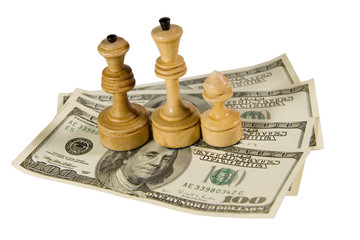 Chess figures (white king, queen and pawn) on US dollars