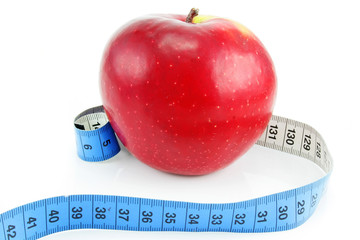 Bright red apple and measuring tape